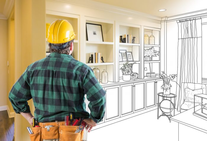 A contractor looking at designs for a living room built-in